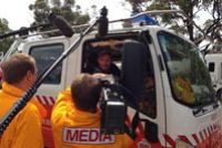 Is Opposition Leader Tony Abbott 'Doing Important Things' for the Rural Fire Brigade?